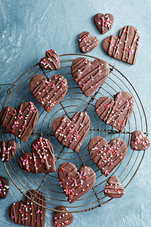 Photo for Chocolate hearts cookies for Valentines day with glaze and sprinkles overhead shot - Royalty Free Image
