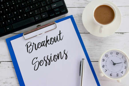 Photo pour Top view of keyboard,coffee,clock,pen,clipboard and paper written with Breakout Sessions. - image libre de droit