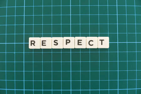 Photo for Respect word made of square letter word on green square mat background. - Royalty Free Image