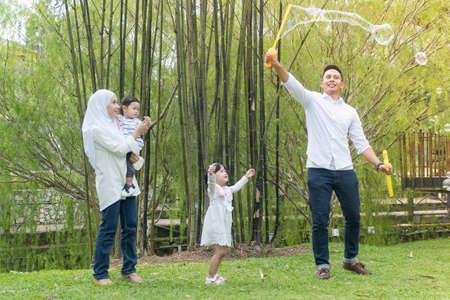 Photo pour Malay family at recreational park having fun - image libre de droit