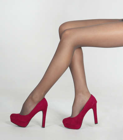 Woman s Legs in Sheer Pantyhose and High Heels