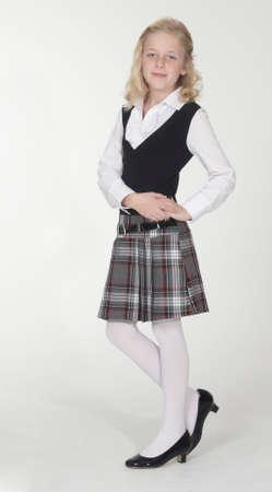 Photo pour Catholic School Girl Posing in School Uniform - image libre de droit