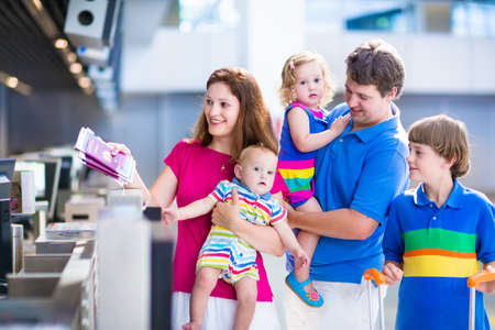 Photo pour Big happy family with three kids traveling by airplane at Dusseldorf International airport, parents with teenager boy, toddler girl and little baby holding colorful luggage for summer beach vacation - image libre de droit