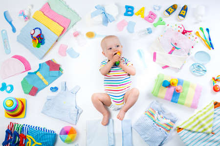 Photo pour Baby on white background with clothing, toiletries, toys and health care accessories. Wish list or shopping overview for pregnancy and baby shower. View from above. Child feeding, changing and bathing - image libre de droit