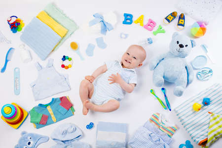 Photo for Baby on white background with clothing, toiletries, toys and health care accessories. Wish list or shopping overview for pregnancy and baby shower. View from above. Child feeding, changing and bathing - Royalty Free Image