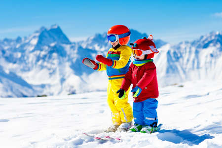 Photo for Child skiing in the mountains. Kid in ski school. Winter sport for kids. Family Christmas vacation in the Alps. Children learn downhill skiing. Alpine ski lesson for boy and girl. Outdoor snow fun. - Royalty Free Image