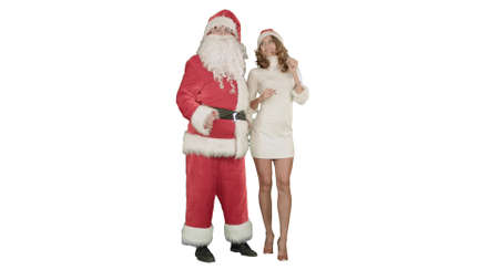 Photo for Christmas happy smile girl dancing with Santa Claus on white background - Royalty Free Image