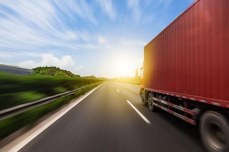 Photo pour Truck on a fast express road, motion blur - image libre de droit