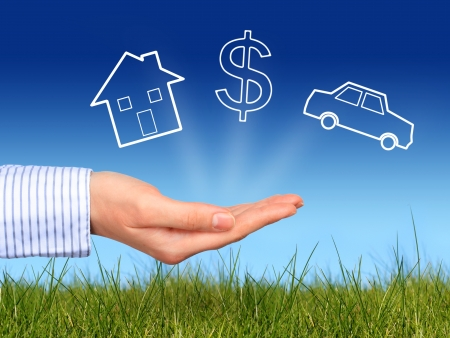 Foto de Dreams. House, dollar symbol and car in hand. - Imagen libre de derechos
