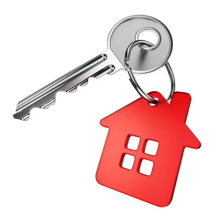 Foto de Metal door key with red house-shape trinket isolated on white background - Imagen libre de derechos