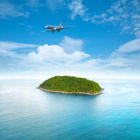 Foto de Private jet plane is over a tropical island  Luxury style living concept    Square composition  - Imagen libre de derechos