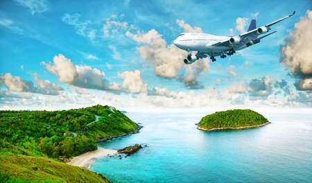 Foto de Jet plane over the tropical island. Panoramic composition in very high resolution. HDR processed. - Imagen libre de derechos