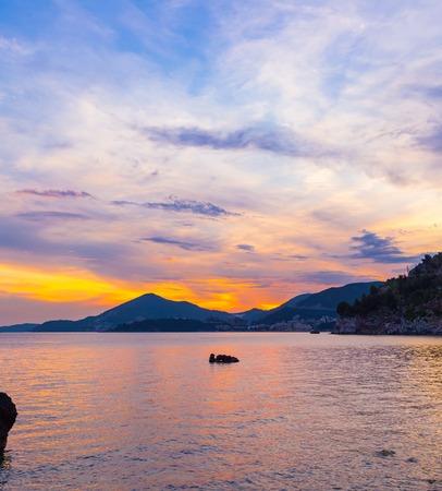 Foto de Awesome colorful sunset on the Adriatic sea coastline in Montenegro, gorgeous seascape. - Imagen libre de derechos