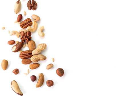 Photo for Background of nuts - pecan, macadamia, walnut, almonds, hazelnuts, and other - with copy space. Isolated one edge. Top view or flat lay - Royalty Free Image
