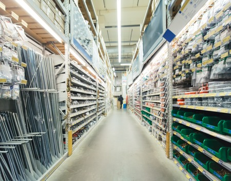 Photo for Blurred warehouse aisle of building materials in industiral DIY store - Royalty Free Image
