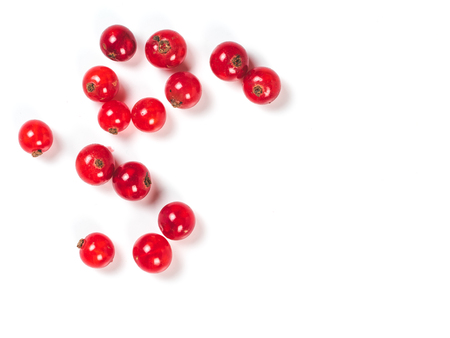 Foto de Creative layout of red currant berries. Food and diet concept. Top view of ripe red currant berries with copy space. Isolated on white with clipping path. - Imagen libre de derechos