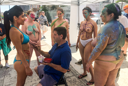 Photo for NEW YORK, NY - JUNE 16: Bodypainter artist Andy Golub prepares  participants for the 36th annual Mermaid Parade in Coney Island on June 16, 2018 in New York City. - Royalty Free Image