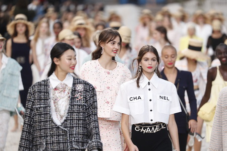 Photo for PARIS, FRANCE - OCTOBER 02: Models walk the runway finale during the Chanel show as part of the Paris Fashion Week Womenswear Spring/Summer 2019 on October 2, 2018 in Paris, France. - Royalty Free Image