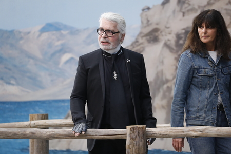 Photo for PARIS, FRANCE - OCTOBER 02: Karl Lagerfeld and Virginie Viard walks the runway after the Chanel show as part of the Paris Fashion Week Womenswear Spring/Summer 2019 on October 2, 2018 in Paris, France. - Royalty Free Image