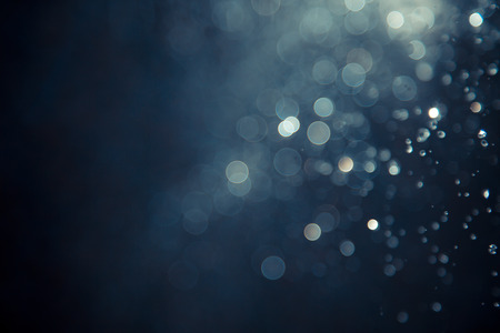 Photo pour bokeh of water fly and lights on black background - image libre de droit