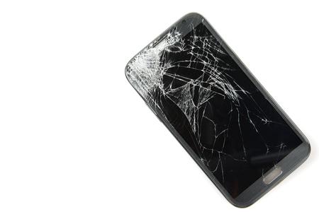Foto de Smartphone drop to the floor and screen damage broken isolated on white background - Imagen libre de derechos