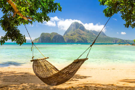 Photo pour Traditional braided hammock in the shade on a tropical island - image libre de droit