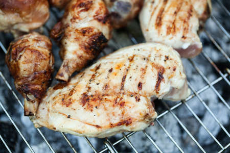 Photo for Chiken on the grill - paleo food photography with shallow depth of field. - Royalty Free Image