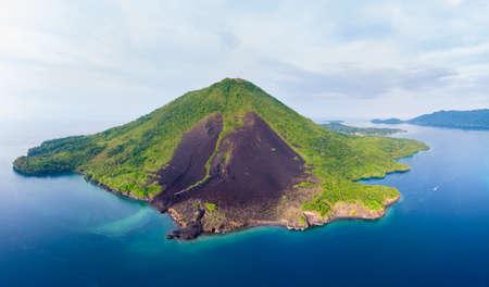 Photo pour Aerial view Banda Islands Moluccas archipelago Indonesia, Pulau Gunung Api, lava flows, coral reef white sand beach. Top travel tourist destination, best diving snorkeling. - image libre de droit