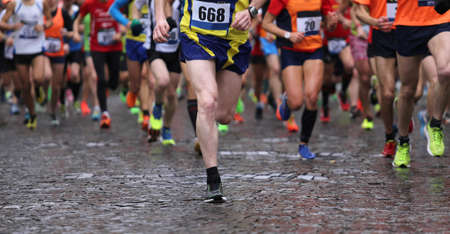 Photo pour group of runners during marathon while it is raining - image libre de droit
