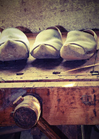 Photo pour Handmade Dutch wooden CLOGS made by a skilled carpenter in the carpentry workshop - image libre de droit