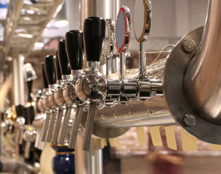 Photo pour brewery taps to deliver the beer to quench the thirst of the pub customers - image libre de droit
