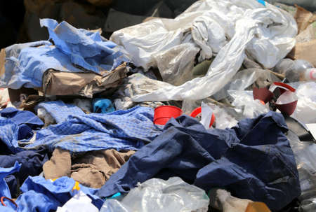 Foto de rags and waste fabrics in the landfill for collecting recyclable material - Imagen libre de derechos