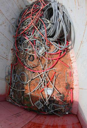 Foto de broken colored electric wires in a garbage container - Imagen libre de derechos