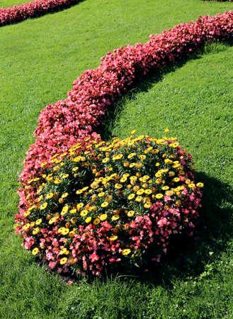 Foto de garden of a large villa is full of well-kept flowers by the gardener - Imagen libre de derechos
