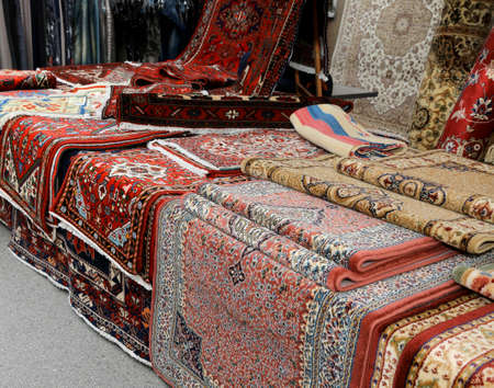 Photo for many carpets for sale at the market stall - Royalty Free Image