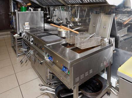 Photo pour Typical and not too clean restaurant kitchen  - image libre de droit