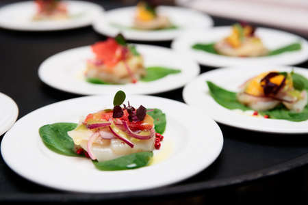 Sea scallop carpaccio dishes on tray