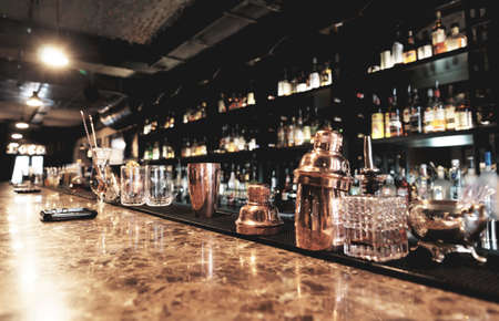 Photo for Classic bar counter with bottles in blurred background - Royalty Free Image