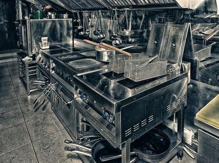 Photo pour Typical and restaurant kitchen, toned image - image libre de droit