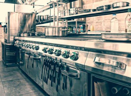 Photo pour Professional kitchen interior, crock on stove, toned image - image libre de droit