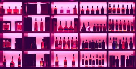 Photo pour Various alcohol bottles in a bar, back light, all logos removed, toned image - image libre de droit