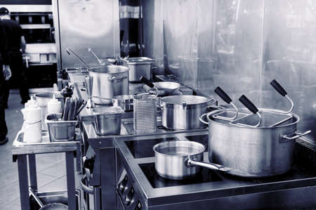 Foto de Typical kitchen of a restaurant in operation, toned image - Imagen libre de derechos