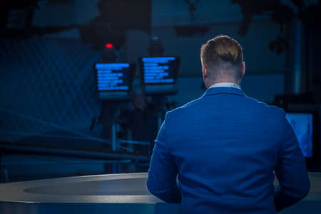 Photo for A journalist working on a computer in Newsroom. Back view - Royalty Free Image