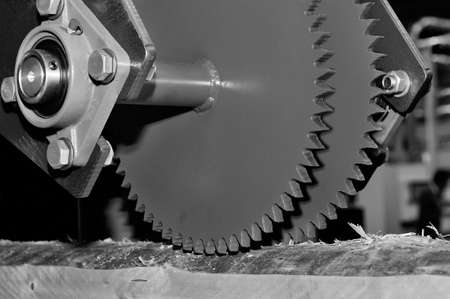 Photo for Industrial woodworking machine with circular saw disk. Milling machine for wood. Black and white toned image - Royalty Free Image