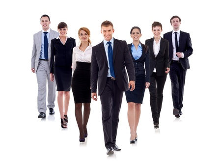 Business team walking forward - leadership and teamwork concepts using a group of businessmen and businesswomen isolated on white
