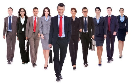Successful happy business team walking towards the camera on white background