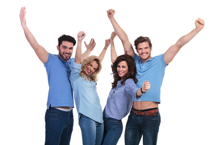 Photo pour happy casual group of people celebrating victory with hands in the air on white background - image libre de droit