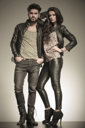 Photo for in love couple dressed in leather clothes in a fashion pose in studio - Royalty Free Image