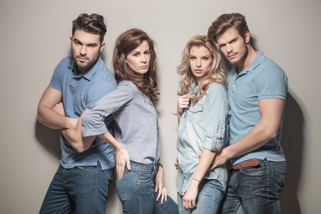 Foto für fashion models in blue jeans and casual polo shirts posing in studio - Lizenzfreies Bild