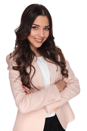 Photo for confident young business woman with hands crossed is smiling on white background - Royalty Free Image